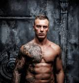 Muscular strong male with tattoo — Stock Photo
