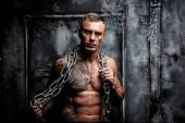 Muscular strong male with tattoo — Стоковое фото