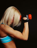 Good-shaped athletic girl covers her face with blonde hairs — Stock Photo