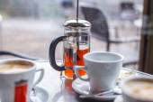 Cups with coffee and teapot — Foto Stock