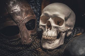 Helmet and skull — Stock Photo