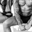 Beautiful girl and fashionable muscular man posing — Stock Photo #63351959