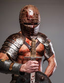 Gladiator holding shield and sword — Stock Photo
