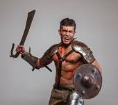 Gladiator in attack position — Stock Photo