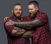 Two brutal males with tattooes and beards — Stock Photo