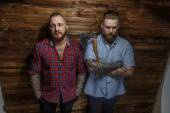 Two huge brutal males with tattooes and beards — Stock Photo