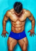 Awesome young muscular male possing — Stock Photo