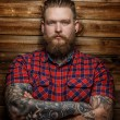 Brutal man with tattooes and beard — Stock Photo #63870107
