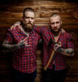 Two tattoed mans with beards. — Stock Photo