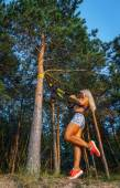 Young woman doing fitness in the forest. — Stock fotografie