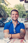 Smiling male in blue t shirt. — Stock Photo