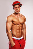 Muscular man in red cap. — Stock Photo