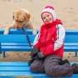Little girl possing with a dog. — Foto Stock #65778485