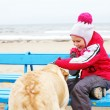 Little girl possing with a dog — Stockfoto #65778775