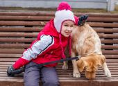 Little girl possing with a dog. — Stock Photo