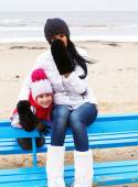 Mother and doughter on a beach — Stock Photo