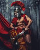Male in roman armor with sword — Stock Photo