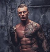 Muscular male with tattoos — Стоковое фото