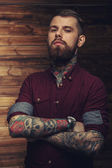 Tattoed male looking seriously — Photo