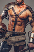 Gladiator with muscular body — Stock Photo