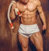 Bodybuilder psoing in the studio. — Stock Photo