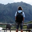 Guy looking at mountains — Stock Photo #68185489