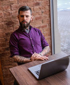 Man working with laptop in cafe — Stock Photo