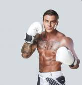 Boxer with tattoo posing in studio — Stock Photo