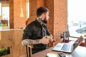 Modern man working with laptop — Stock Photo