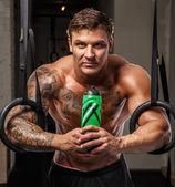 Tattoed bodybuilder on a rest — Stock Photo
