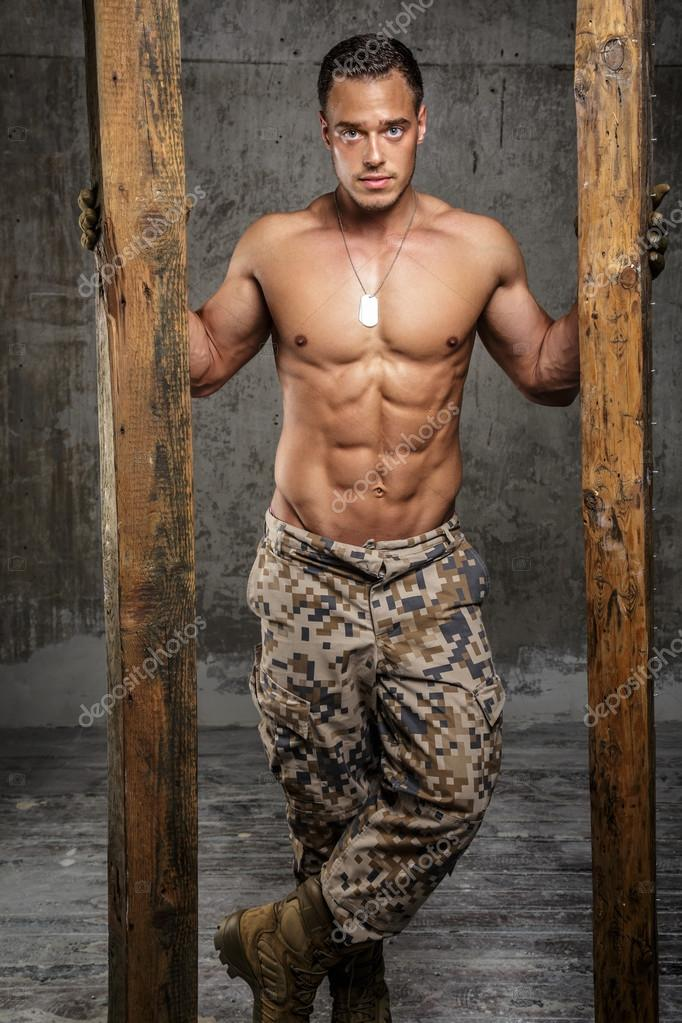 Awesome army man with naked torso — Stock Photo #70420417