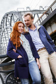 Smiling happy couple near a river — Stock Photo