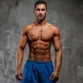 Muscular shirtless fitness man — Stock Photo