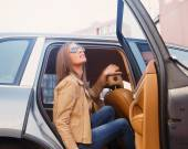 Casual female posing in the car — Stock Photo