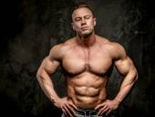 Shirtless big bodybuilder posing in studio — Stock Photo