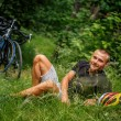 Man lying on grass in the forest. — Stock Photo #75726417