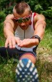 Male in sportswear doing body extension — Stock Photo