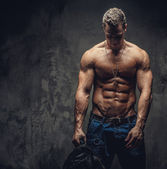 Shirtless man in blue jeans — Stock Photo