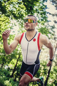 Happy man in sportswear and sunglasses — Stock Photo