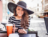 Smiling young woman in black shirt with white stripes — Stock Photo