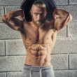 Shirtless muscular athlete guy holding weights. — Стоковое фото #80998724