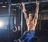 Shirtless muscular man in blue sports pants. — Stock Photo