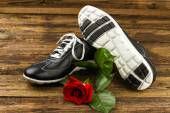 Black man's shoes and rose — Stock Photo