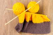 Yarn, knitting needles and scarf — Stock Photo