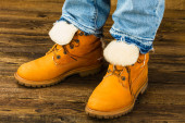Female feet in winter boots and jeans — Stock Photo