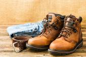 Men's boots, jeans and belt — Stock Photo