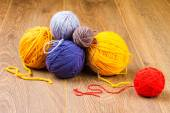 Yellow, dark blue, lilac, brown and red yarn — Stock Photo