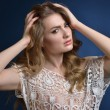 Beautiful woman in lace white blouse. — Stock Photo #53533219