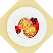 Dish of pancakes with cherry sause on white plate. — Stock Photo