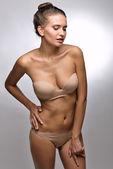 Beautiful woman in flesh color underwear. — Stock Photo